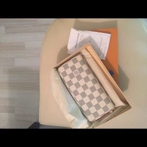 Authentic Louis Vuitton Clemence wallet white